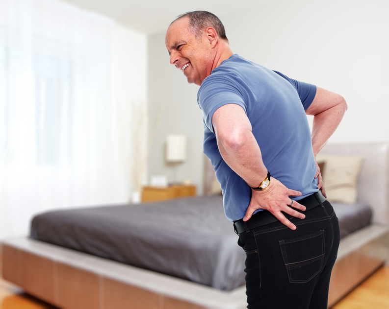 Senior man with a back pain.