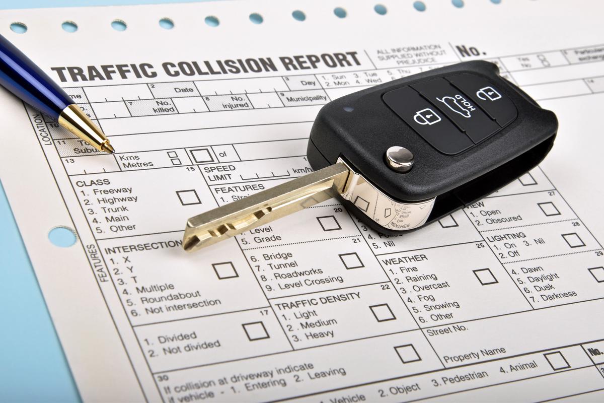 stockfresh_7165495_car-key-and-crash-report_resize